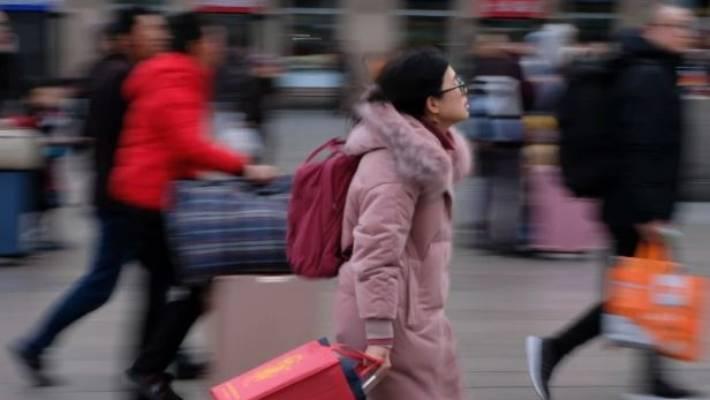 Passengers rush to Beijing Railway Station, many heading home for Spring Festival.