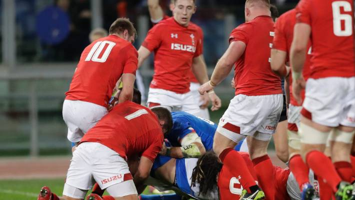 Italy's Braam Steyn, covered by players, scores a try against Wales in their Six Nations clash in Rome.