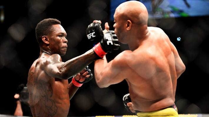 Israel Adesanya lands a right hand strike on Anderson Silva during his unanimous decision victory