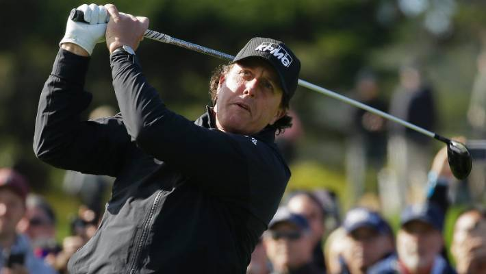 Phil Mickelson was not happy at having to return on Tuesday to play the final two holes after bad light stopped play