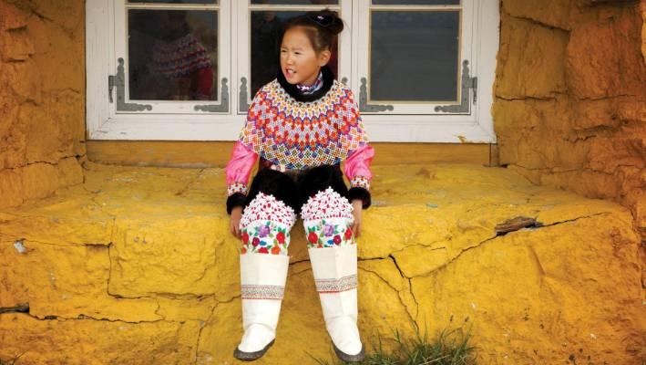 Greenlandic girl in window.