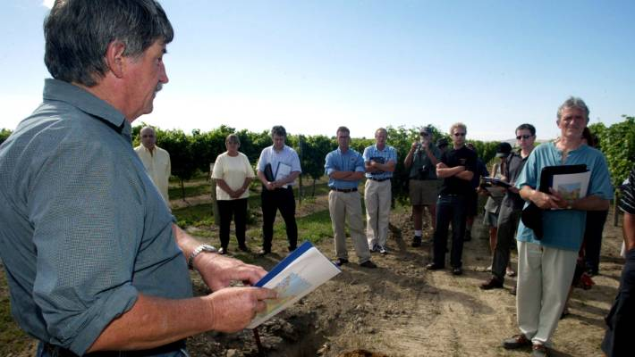 Graeme McLean has owned and sold commercial property and made wine during his business life. Here he is showing international and national wine distributors and writers through one of his vineyards in Marlborough 15 years ago.