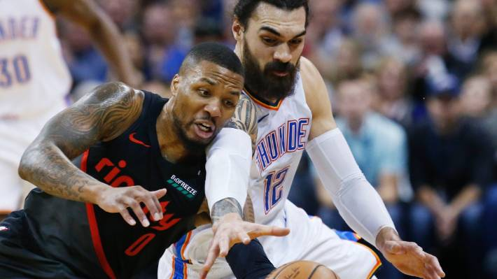 Steven Adams fights for possession with Portland guard Damian Lillard during the Thunder's win.