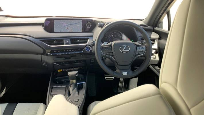 Interior has luxury-car look and feel. Annoying touchpad continues - but now there are more switchgear shortcuts.
