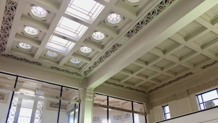The main pattern on the ASB Bank's ceiling is Kowhaiwhai - traditional red, white and black Maori patterns. Other motifs are of taiaha - spearheads - and darts, reflecting the bank's role of  protection.