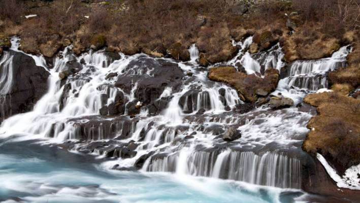 Hraunfossar Waterfalls in Reykholt Valley in West Iceland.