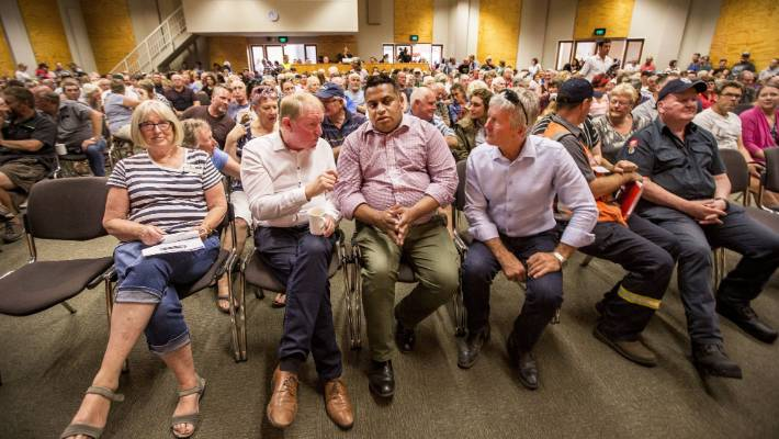 Nelson MP Dr Nick Smith, left, and West Coast-Tasman MP Damien O'Connor flank Minister of Civil Defence Kris Faafoi at a meeting for families affected by the Tasman district forest fire.