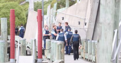 Police are investigating the 'unexplained' death of a woman found in the boatshed lagoon in Wellington on Saturday.