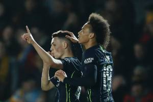 Manchester City's Phil Foden (L) is congratulated by Leroy Sane after scoring in a 4-1 FA Cup win over Welsh club ...