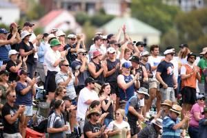 Fans at Dunedin's University Oval acknowledge Black Cap Ross Taylor after he surpassed Stephen Fleming to become New ...