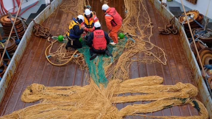 The crew of Tangaroa preparing the mesopelagic trawl net, which is used to sample mid-water fish, krill, and other larger zooplankton. There were 41 fish trawls during the voyage. The total trawl catch of 1946 kilograms was made up of 110 species, including 56 types of fish.