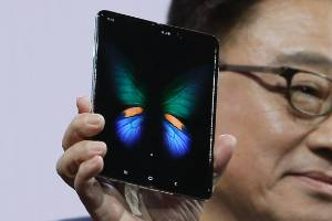 DJ Koh, President and CEO of IT and Mobile Communications, holds up the new Samsung Galaxy Fold smartphone.