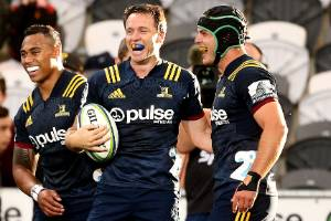 Ben Smith celebrates his try against the Reds during the Highlanders' 36-31 win on Friday night.