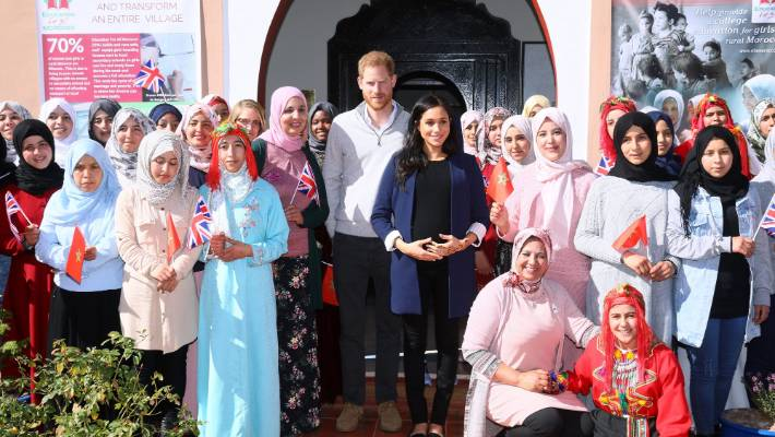 "Prince Harry, the Duke of Sussex and Meghan, The Duchess of Sussex, stand up with staff and daughters long, as they visit the ""Education for All"" board for girls aged 12 to 18."