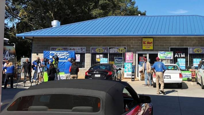 Media outside the KC Mart in Simpsonville after it was announced the winning Mega Millions lottery ticket was purchased at the store