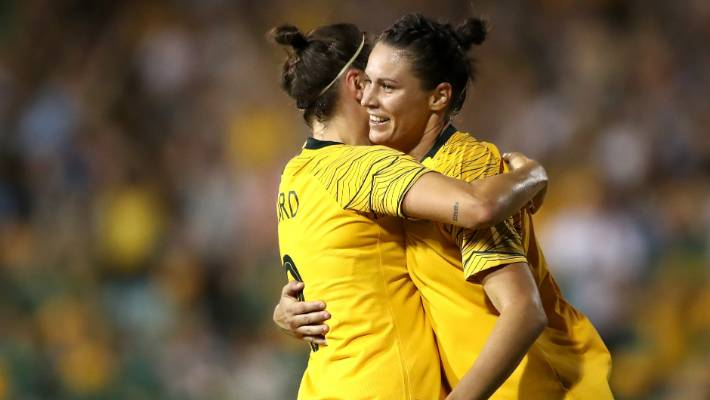 Emily Gielnik of the Matildas is to sign her in front.