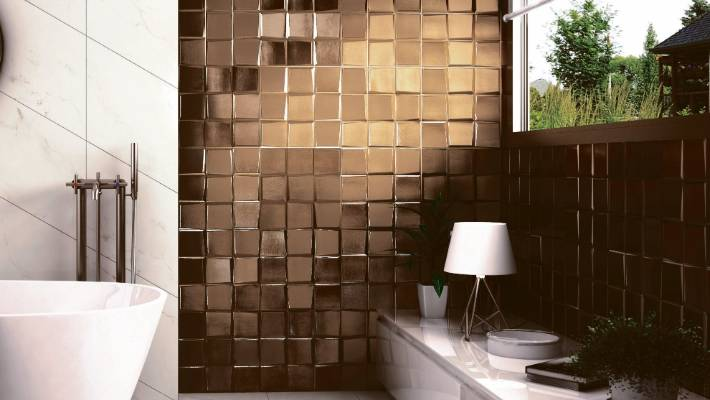 The 3D Pattern range in Oro from Tile Trends simultaneously provides a metallic and textural look