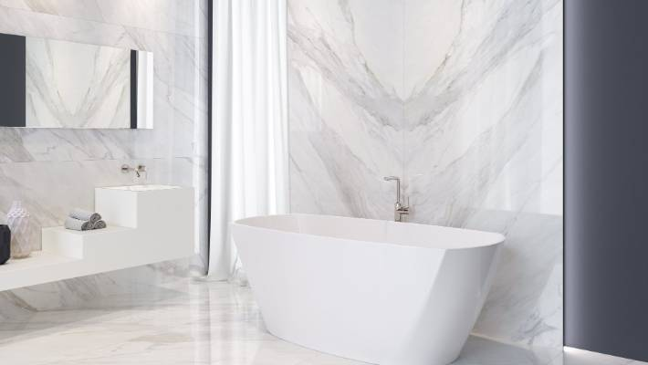 The Coverlam porcelain sheeting in this bathroom spans floor-to-ceiling.
