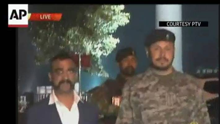 In this image made from video provided by PTV, Wing Commander Abhinandan Varthaman walks to cross the border into India, in Wagah, Pakistan.