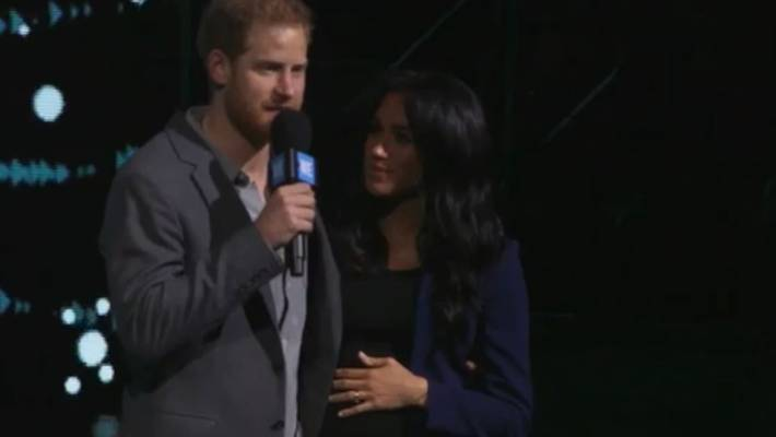 Meghan makes surprise appearance as Prince Harry 'drags' her on stage