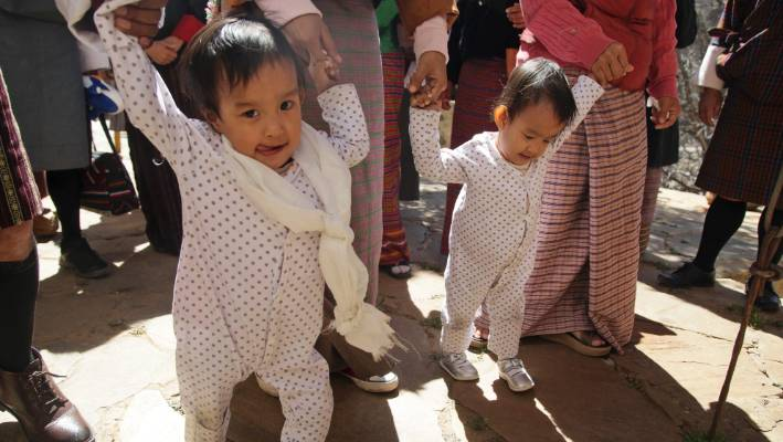 Bhutanese twin girls Nima and Dawa can walk for the first time after being separated in an operation in Australia.