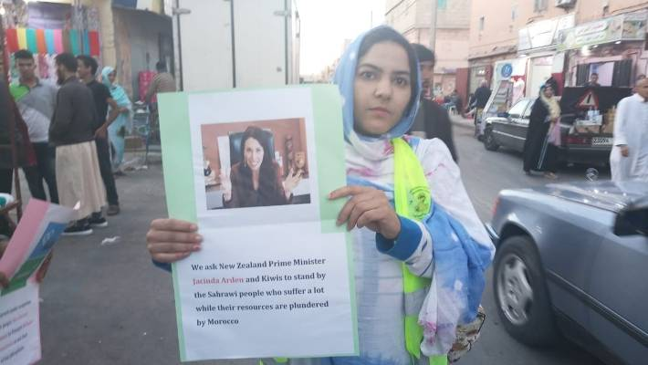 A Western Saharawi protester calls on PM Jacinda Ardern to intercede over phosphate exports to New Zealand from North Africa.