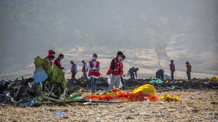Rescuers work at the scene of an Ethiopian Airlines flight crash near Bishoftu or Debre Zeit south of Addis Ababa Ethiopia