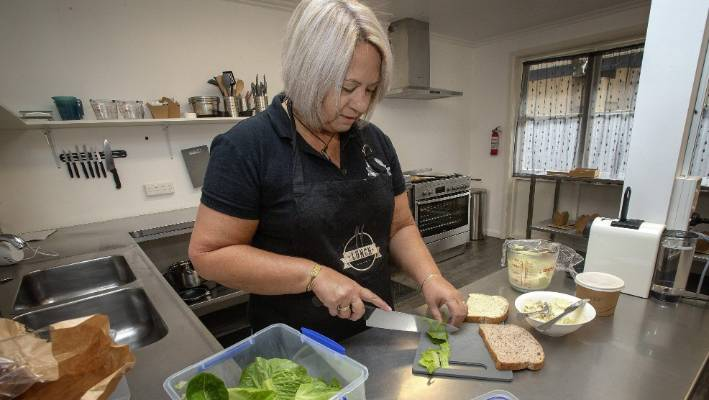 Sandy Hight prepares a chicken and avocado sandwich.