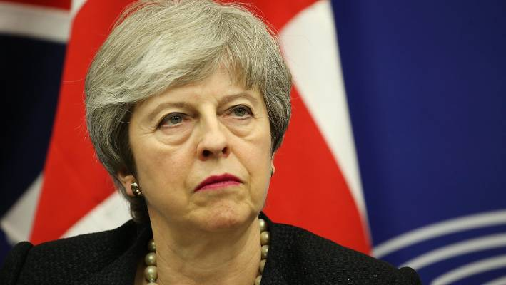 Britain's Parliament strongly rejects prime minister's Brexit deal in major blow to her EU divorce plans