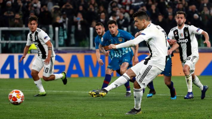 Cristiano Ronaldo slots home from the penalty spot to complete his hat-trick and send Juventus through