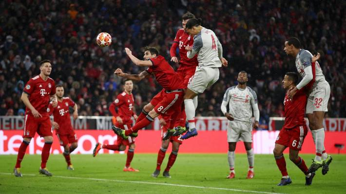 Virgil van Dijk outjleaps the Bayern defence to head in Liverpool's second goal from James Milner's cross