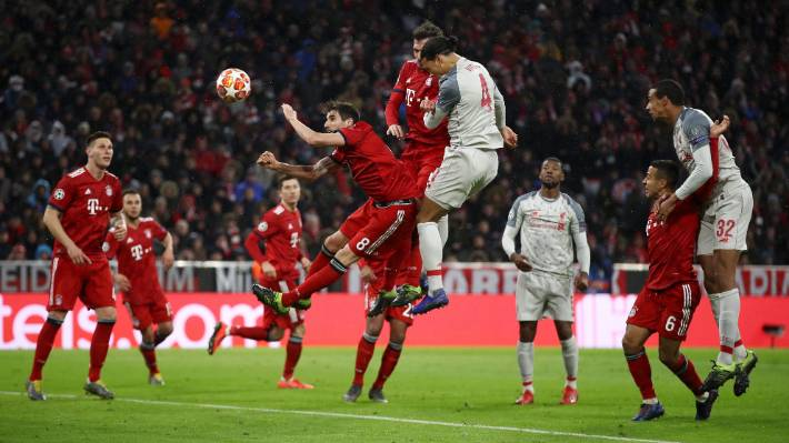 Liverpool defender Virgil van Dijk heads home during their win over Bayern Munich