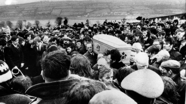 Pallbearers carry one of 13 coffins of Bloody Sunday victims to a graveside during a funeral in Londonderry on February 2,1972