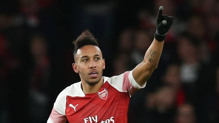 Unmasked- Pierre Emerick Aubameyang of Arsenal celebrates one of his two goals