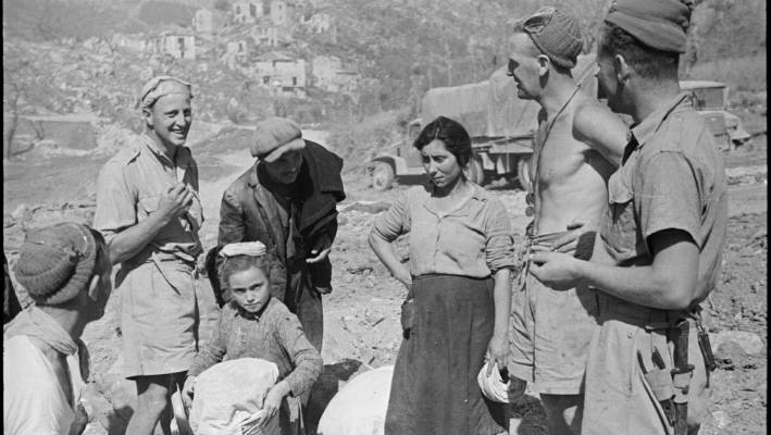 02b8ee57 New Zealand soldiers talking to refugees near Atina, Italy, World War II.  Reproduced
