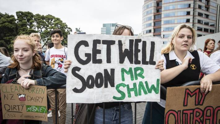 A protester expresses her sympathy to Climate Change Minister James Shaw after he was assaulted.