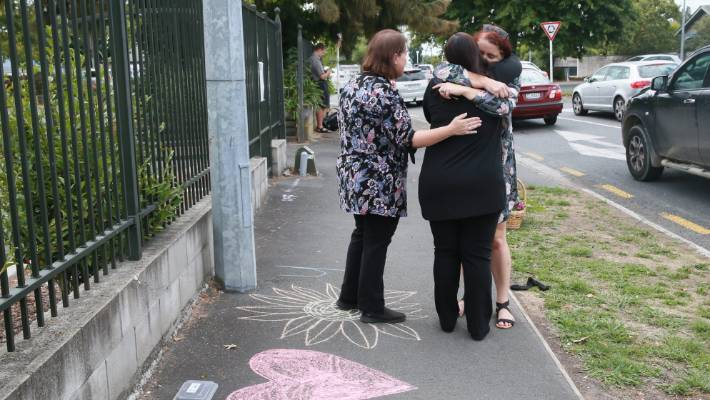 Tributes to the fallen were chalked on the footpath outside the Hamilton Jamia Masjid Mosque.