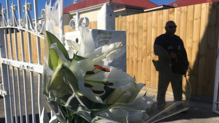 White lilies and armed police outside Auckland's Ponsonby Mosque.