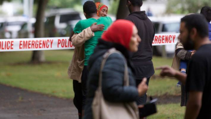 Worshipers emerge from the Deans Ave mosque in Christchurch, hours after a shooter opened fire.