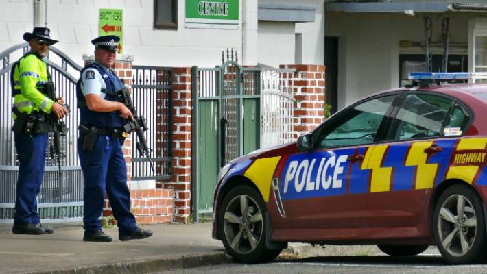 Armed police guard a Mosque in Invercargill.
