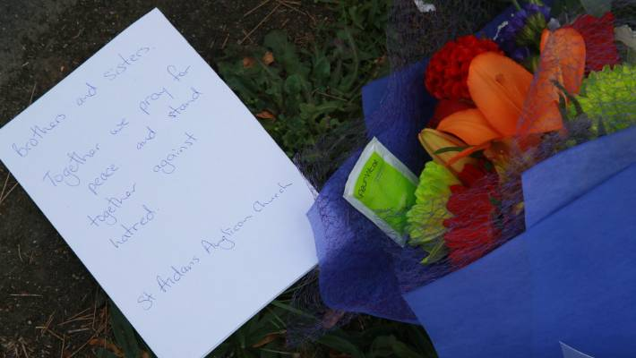 Flowers and notes of support were left outside Hamilton's Mosque.