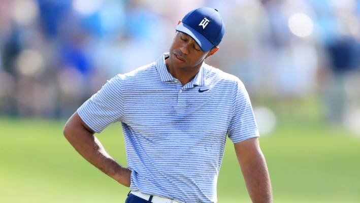 Tiger Woods reacts after a quadruple bogey on the 17th hole during the second round of The Players Championship
