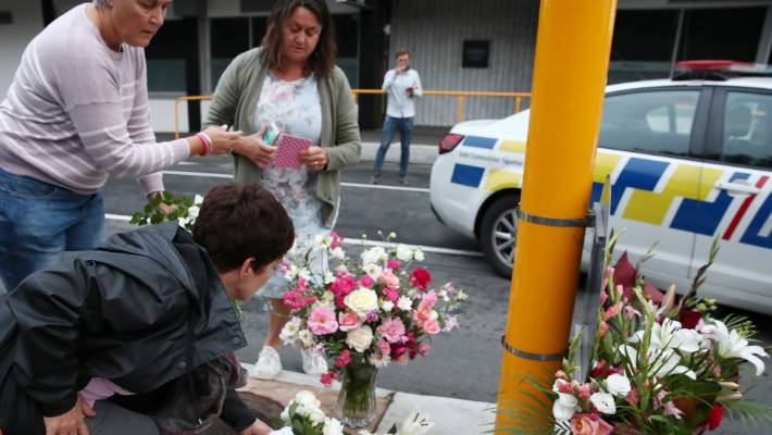 Residents leave floral tributes at Deans Avenue near the Al Noor Mosque in Christchurch.
