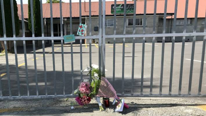 Christchurch residents leave flowers and cards outside the United Afghan Association of Canterbury building in Bishopdale.