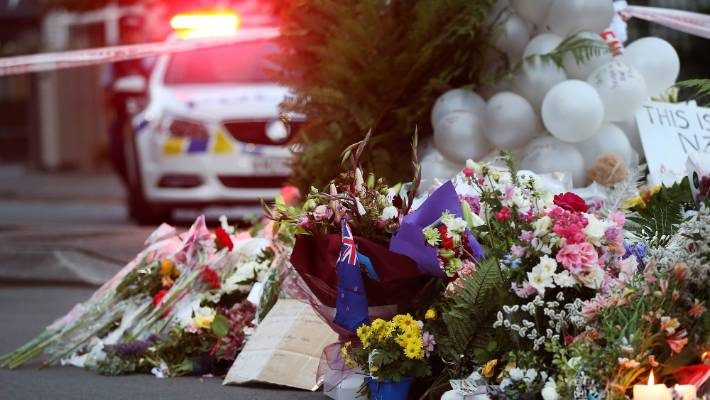 Flowers are left at the Al Noor mosque after the shootings in Christchurch on Friday