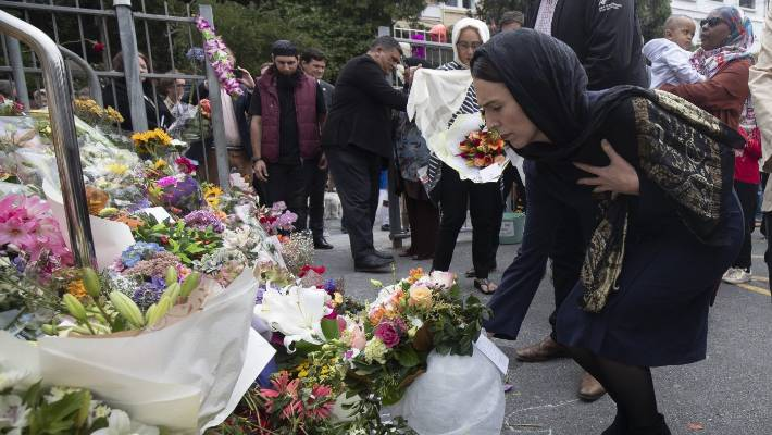 PM Jacinda Ardern lays down flowers at the Wellington Islamic Community.