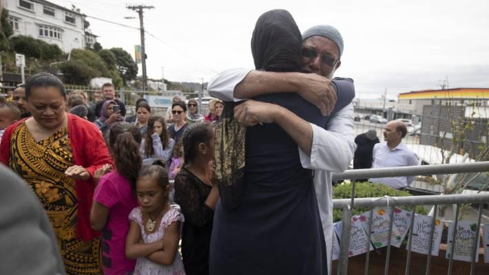PM Jacinda Ardern and Yakub Khan hug in an emotional scene.