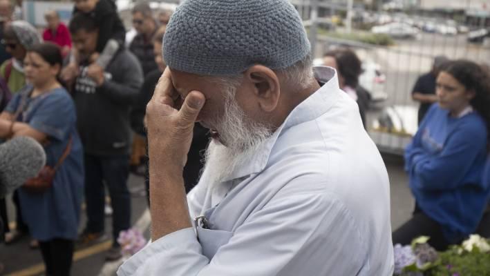 Yakub Khan from the Kilbirnie Mosque weeps as people sing .