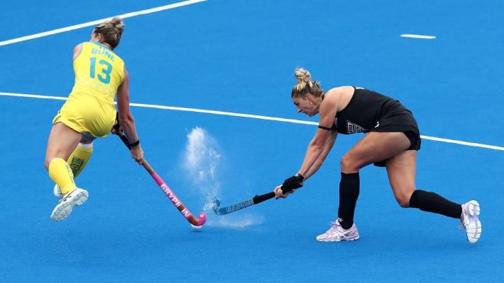 Olivia Merry of New Zealand has a shot blocked by Edwina Bone of Australia during the Pro League match.