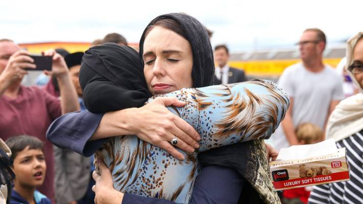 Prime Minister Jacinda Ardern hugs a mosque-goer at the Kilbirnie Mosque on in Wellington. Fifty people are confirmed dead following the shooting attacks on two mosques in Christchurch on Friday.